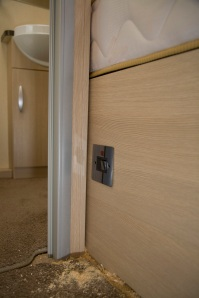 Installing an electric towel rail in a caravan - Faceplate fitted in place