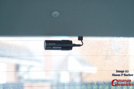 The rear camera is installed at the top of the window avoiding getting one of the heating elements in view